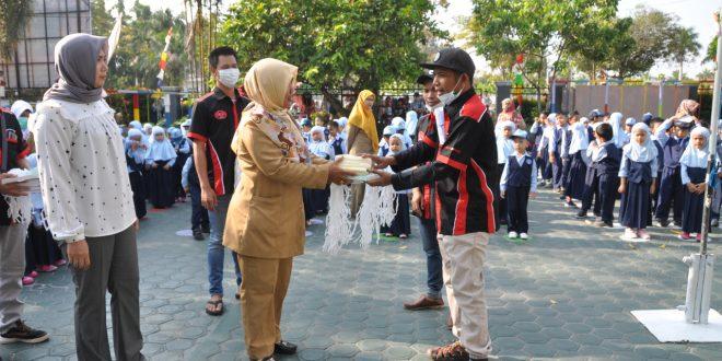 Komunitas Pencinta Otomotif Bagi 4.000 Masker